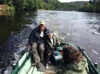 Boat Fishing The River For Salmon